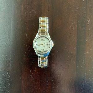 Women's silver and gold Citizen watch